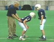 sandusky-behind-kid-at-practice1